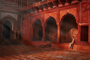young guy sitting under the rays of the morning sun and watching the Taj Mahal mosque Wall mural