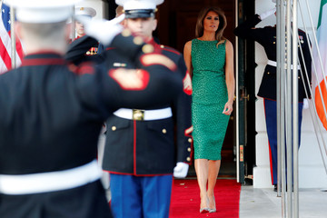 U.S. first lady Melania Trump walks out with President Donald Trump to greet Ireland's Prime Minister, Taoiseach Leo Varadkar for a St. Patrick's Day reception at the White House