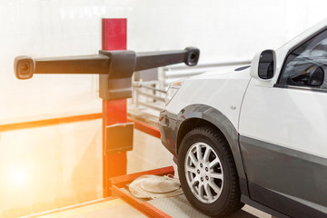 Car at service station. Wheel laser alingment equipment.  Vehicle maintenance  and check up concept