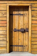 Rustic wooden fortress door with old iron latch