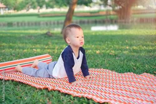 Cute Little Asian 18 Months 1 Year Old Toddler Baby Boy Child Concentration On Practices