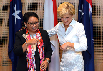 Australia's Foreign Minister Julie Bishop stands with her Indonesian counterpart Retno Marsudi laugh during the Australia-Indonesia Maritime Cooperation Plan of Action signing ceremony in Sydney
