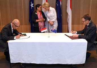 Australia's Foreign Minister Julie Bishop stands with her Indonesian counterpart Retno Marsudi talk during the signing ceremony for the Australia-Indonesia Maritime Cooperation Plan of Action signing ceremony in Sydney