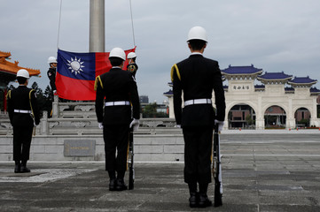 Military honour guards attend a flag-raising ceremony at Chiang Kai-shek Memorial Hall, in Taipei