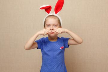 Lovely child. Shot of a beautiful little girl wearing bunny ears