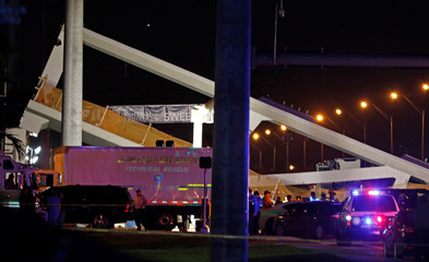 First responders continue on rescue efforts after a pedestrian bridge collapsed at Florida International University in Miami