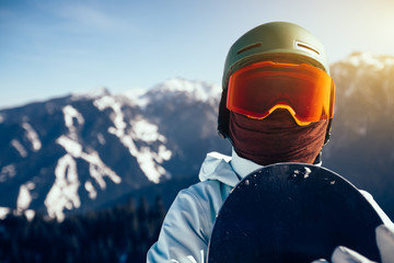 one snowboarder with snowboard on winter mountain top Wall mural