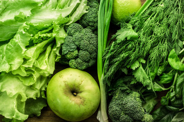 Green vegetables, fruits and greenery food background. Top view