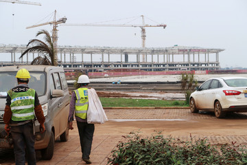 Workers leave the construction site for a new terminal at Haikou Meilan International Airport in Hainan
