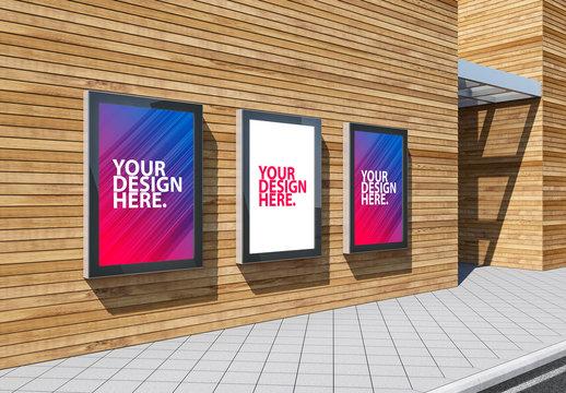 3 Advertising Kiosk Mockups on Wooden Plank Building