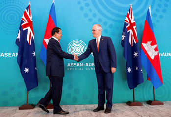 Australian Prime Minister Malcolm Turnbull shakes hands with Cambodia's Prime Minister Hun Sen before their bilateral meeting during the one-off ASEAN summit in Sydney