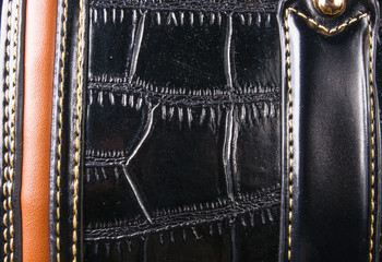 seams on leather hand bag