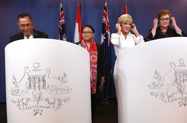 Indonesia's Defence Minister Ryamizard Ryacudu and Foreign Minister Retno Marsudi stand with Australia's Foreign Minister Julie Bishop and Defence Minister Marise Payne during a media conference after their bilateral meeting in Sydney