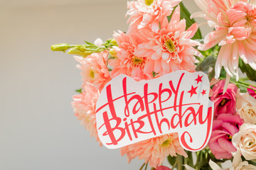soft pink chrysanthemums and happy birthday poster.beautiful flowers with a text signboard.Happy Birthday Greeting Card with Spring Bouquet