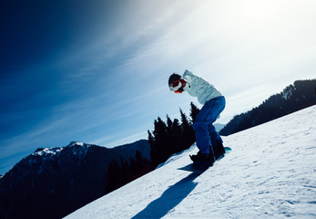 one snowboarder snowboarding in winter mountains