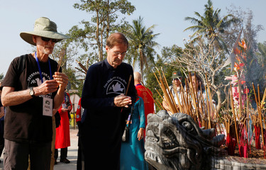 U.S. veterans Paul Ross and Jon Janas prays during the 50th anniversary of the My Lai massacre in My Lai village