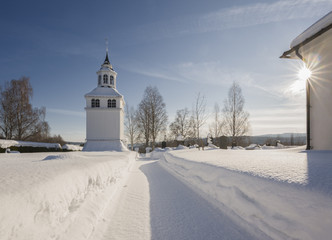 tower with an church in a winter landscape