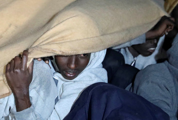 Migrants are seen after they were rescued by Libyan coast guards in the Mediterranean Sea