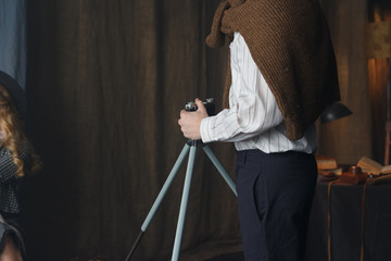 Photographer working with model in studio, vintage
