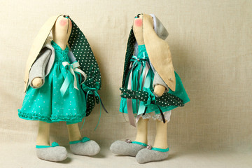 two toy rabbits in dresses, easter