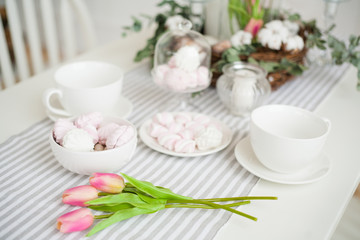 cup and white and pink marshmallow on decorated table
