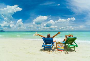 Couple on the beach at tropical resort iin Thailand