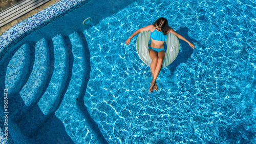 Aerial top view of beautiful girl in swimming pool from - Swimming pool girl christmas vacation ...