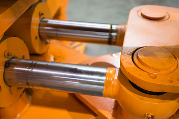 Hydraulic pistons in heavy duty machinery