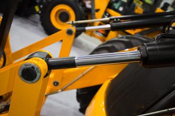 Hydraulic pistons in heavy duty machinery