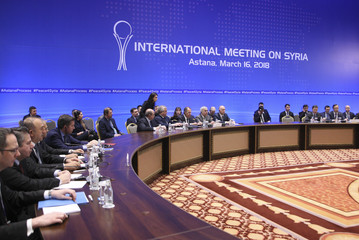 Members of the delegations take part in the international meeting on Syria in Astana