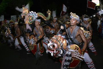Balinese Hindu men perform during Tektekan, a traditional ceremony believed to expel evil spirits, ahead of the holy day Nyepi, in Tabanan, Bali