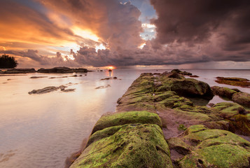 Sunset seascape with natural coastal rocks  at Kudat, Sabah Malaysia.