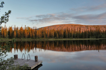 Midnight sun colouring the Luosto mountain in Lapland, Finland