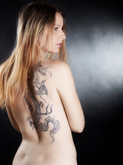 Blonde young woman with tattoo
