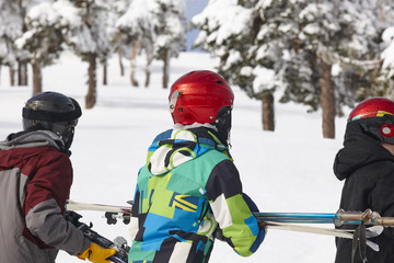 Children starting learn skiing with equipment on snow. Winter