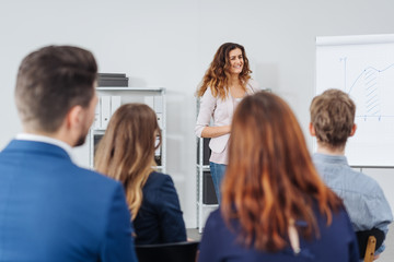 Woman lecturing a group of businesspeople