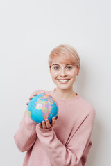 Pretty woman with short haircut holding globe