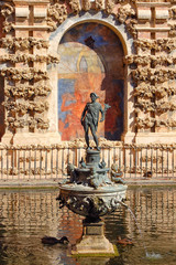 The figure of the god Mercury in one of the ponds of the Royal Palace (Real Alcazar) - Seville, Andalucia, Spain