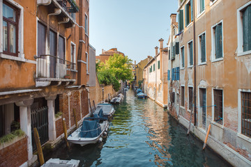 Poster Channel Venice, beautiful romantic italian city on sea with great canal and gondolas. View of venetian narrow canal. Venice is a popular tourist destination of Europe.