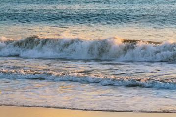 Bali summer vacation background texture with high water waves at sunset