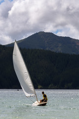 Young man on the sailing boat