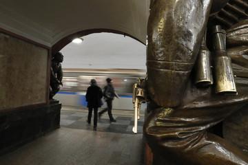 People walk on the platform of Ploshchad Revolyutsii metro station in Moscow