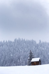 Wooden barn on Romanian mountains at winter