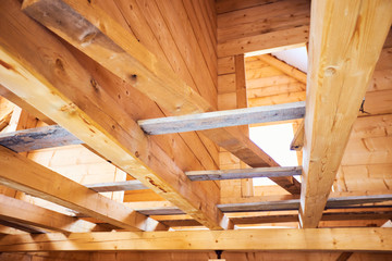 Wooden roof construction symbolic photo for home house building and house financing.