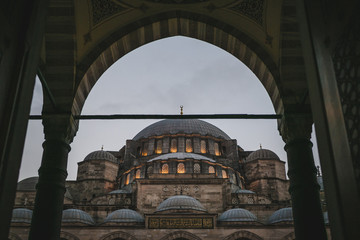 view through arch on suleymaniye mosque in evening in Istanbul, Turkey