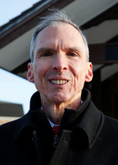 U.S. Congressman Daniel Lipinski poses for a picture after campaigning for re-election at the Chicago Ridge Metra commuter train station in Chicago Ridge
