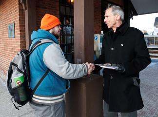 U.S. Congressman Daniel Lipinski campaigns for re-election at the Chicago Ridge Metra commuter train station in Chicago Ridge