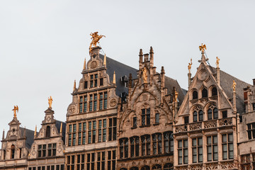 beautiful ancient buildings with sculptures in historical quarter of Antwerp, Belgium