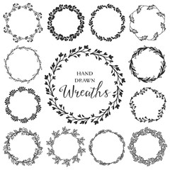 Vintage set of hand drawn rustic wreaths. Floral vector graphic. Nature design elements.