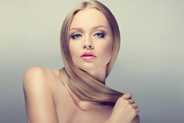 Beauty Woman Portrait. Perfect Fresh Skin. healthy well-groomed hair. Youth and Skin Care Concept.